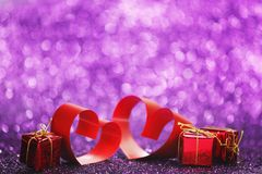Red ribbon hearts on glitters Stock Images