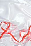 Red ribbon hearts Royalty Free Stock Images