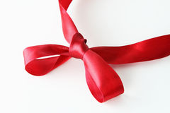 Red Ribbon Knot. Red ribbon bow knot on white background royalty free stock photo