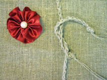 Red ribbon on linen fabric royalty free stock photos