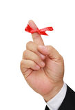 Red ribbon and the man's hand Royalty Free Stock Image