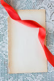Red Ribbon and old paper Stock Image