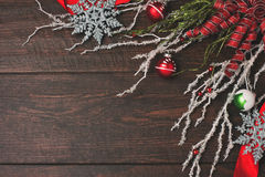 Red ribbon and ornaments a rustic wood background Royalty Free Stock Photo