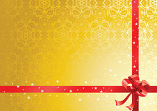 Red ribbon over gold background Royalty Free Stock Images