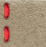 Red ribbon over paper texture Royalty Free Stock Photos
