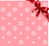 Red ribbon on pink snowflakes background Royalty Free Stock Photos