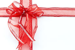 Red ribbon placed as wrapped package on white background Stock Photography