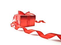 Red ribbon and red gift box. On white background stock image