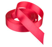 Red ribbon roll. Isolated on white background Royalty Free Stock Photo