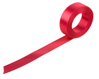 Red ribbon roll. On white background Stock Image
