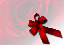Red ribbon on rose flower background Royalty Free Stock Photos