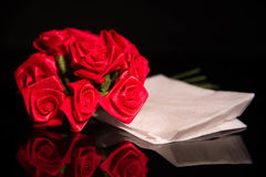 Red ribbon roses and the white paper Stock Photo