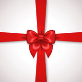 Red Ribbon with Satin Bow Tied Around Gift Box Royalty Free Stock Photo