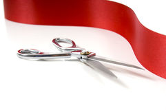 Red Ribbon and Scissors Royalty Free Stock Images