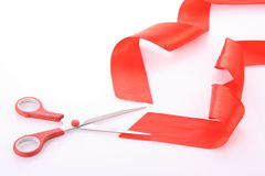 Red ribbon with scissors isolated Royalty Free Stock Photo