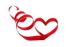 Red ribbon shaped as hearts on white Stock Photo