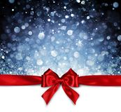 Red Ribbon With Shiny Blue Background. Christmas Card royalty free stock photos