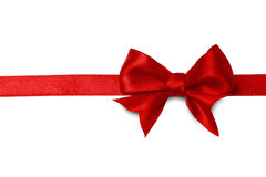 Red ribbon. Shiny red satin ribbon on white background Royalty Free Stock Photos