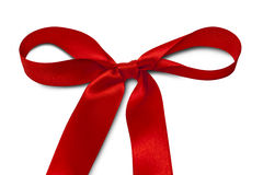 Red ribbon. Shiny red satin ribbon on white background Royalty Free Stock Photography
