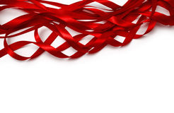 Red ribbon. Shiny red satin ribbon on white background Stock Image