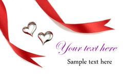 Red ribbon and silver hearts. On white background Royalty Free Stock Photography