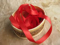 Red ribbon in small box Stock Images