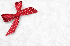 Red ribbon in snow Stock Image