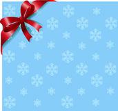 Red ribbon on snowflakes background Royalty Free Stock Image