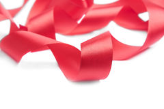 Red ribbon spiral on a white background. Royalty Free Stock Image