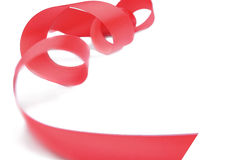 Red ribbon spiral on a white background. Stock Images