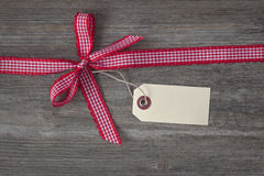 Red ribbon with a tag Royalty Free Stock Photography