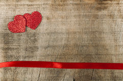 Red ribbon tape and hearts Royalty Free Stock Photography
