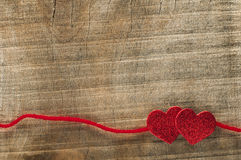 Red ribbon tape and two hearts Stock Images