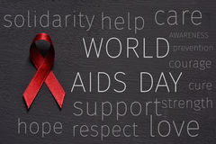 Red ribbon and text world aids day Stock Photo