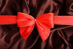 Red ribbon on textile Royalty Free Stock Images