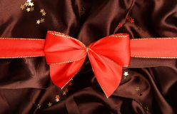 Red ribbon  on textile background Royalty Free Stock Images