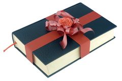 Red ribbon tied black book Royalty Free Stock Photography
