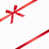 Red ribbon tied in a bow Royalty Free Stock Photos