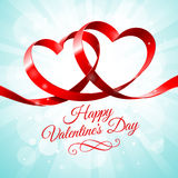 Red Ribbon with two hearts intertwined Royalty Free Stock Images