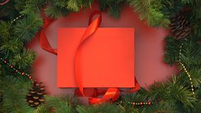 Red ribbon untying and giftbox with wooden christmas toys opening, decoration. Stock footage