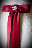 Red ribbon on wedding dress Stock Photos