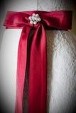 Red ribbon on wedding dress Stock Photos