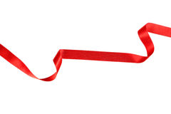 Red ribbon on white background. Royalty Free Stock Photo