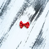 Red ribbon on white paint background. Top view Stock Photos