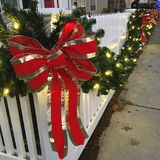 Red ribbon on a white picket fence Royalty Free Stock Images