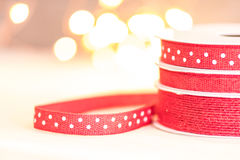 Red Ribbon with White Polka Dots. In front of bright bokeh background royalty free stock image