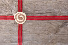 Red ribbon on wood Stock Photography