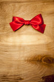 Red Ribbon. On Wood Background Stock Image