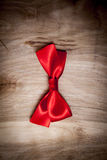 Red Ribbon. On Wood Background Royalty Free Stock Images