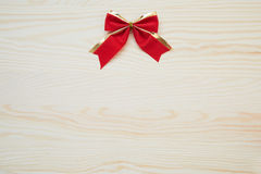 Red ribbon on a wood background with clipping paths. Red ribbon on a wood background Royalty Free Stock Photos